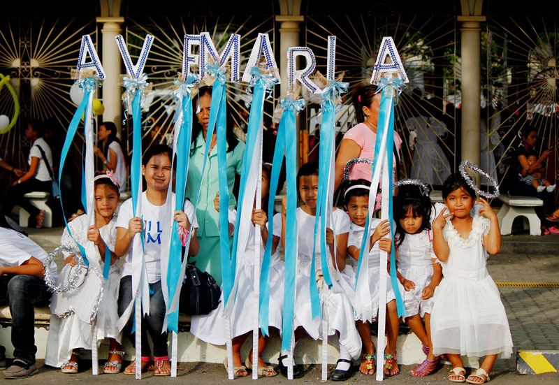 Children dressed as angels participate in Flores de Tagumeño.  (Contributed photo by Kits Quilla)