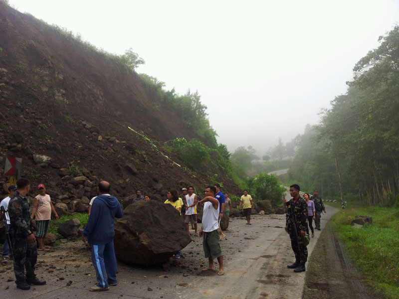 Boulders block part of this road in Kimadsil village, Carmen town following the 5.7 magnitude earthquake Saturday evening.  (photo courtesy of the Office of Governor Emmylou Taliño-Mendoza)