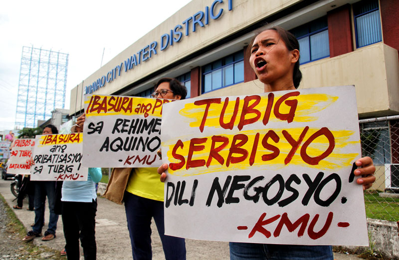 WATER NOT FOR SALE. Women workers voice their opposition to plans of privatizing Davao City Water District in this picket at the DCWD Office in Matina.  Davao's Aboitiz Power Corporation is said to be interested in acquiring DCWD (davaotoday.com photo by Ace Morandante)