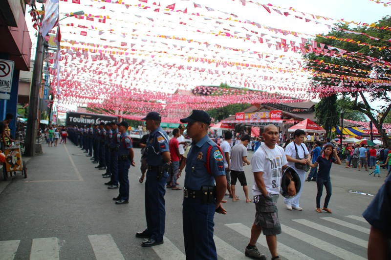 More cops than watchers at the start of the parade along San Pedro Street (davaotoday.com photo by Jandy Lizondra)