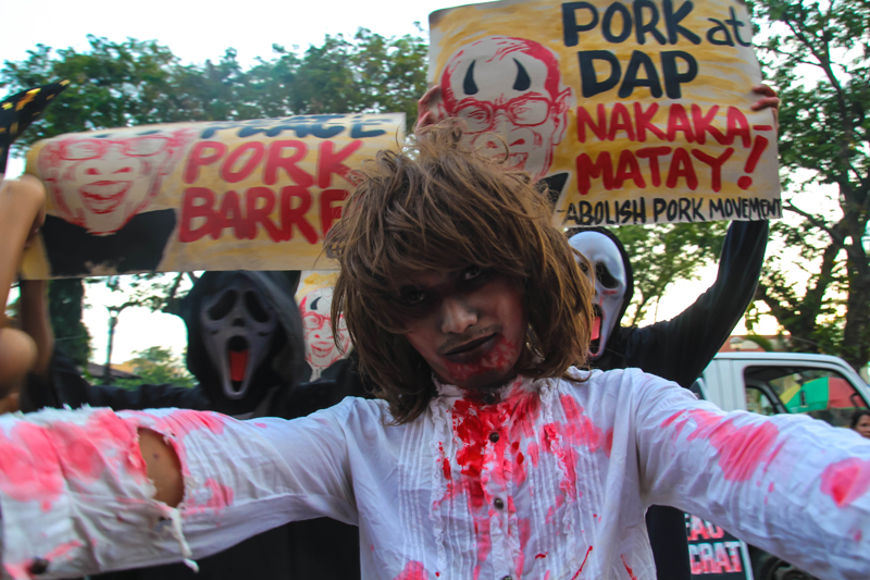 SCARING THE PORK AWAY Activists in Davao staged a Halloween costume protest along San Pedro Street to air their call for the abolition of the President's special funds, DAP and pork barrel funds. (davaotoday.com photo by Ace R. Morandante)