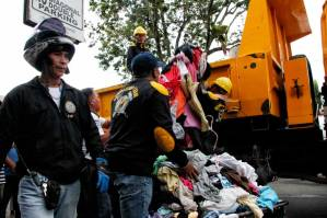 Ukay-ukay clothes get carted away by the city's demolition team operation along City Hall Drive. (davaotoday.com photo by Medel V. Hernani)