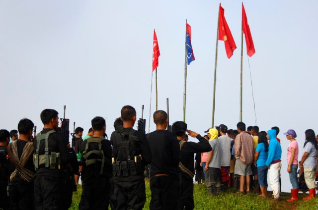 New People's Army and farmers celebrate the  45th anniversary of the Communist Party of the Philippines somewhere in Compostela Valley. (davaotoday.com photo by Mart D. Sambalud)