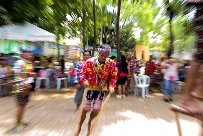 A Lumad keeps his balance at the wooden stilt, made from tree branches, as he races to the finish line in the tribal festival of games featured in this year's Kadayawan festival of Davao City.