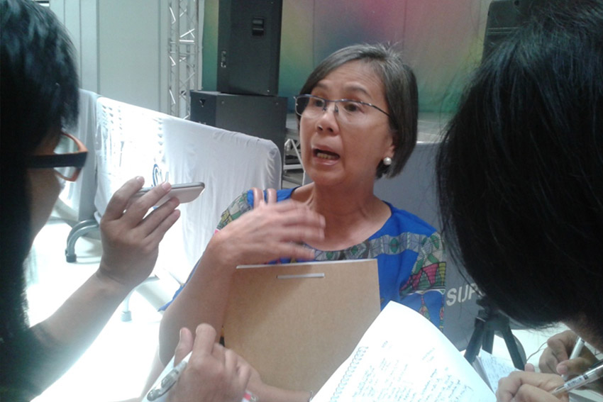 Engineer Carolina Angel, OIC of the National Housing Authority Region 11, explains to reporters the delay of constructing 17,000 houses for Typhoon Pablo survivors due to lengthy time to get clearances from government. (Tyrone A. Velez, davaotoday.com)