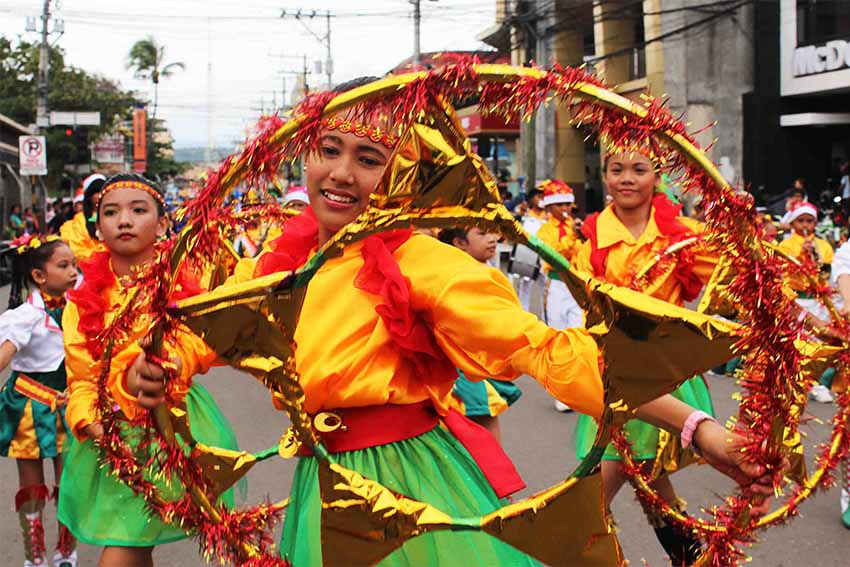 Public school students in colorful costumes are among the participants during the Pasko Fiesta 2015 parade held at the Rizal Park. (Medel V. Hernani/davaotoday.com file photo)