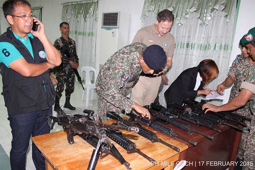 The Moro Islamic Liberation Front returns today weapons they seized fom PNP-SAF commandos to the government peace panel in Camp Siongco, Awang, Datu Odin Sinsuat Maguindanao. (photo credits: OPAPP)