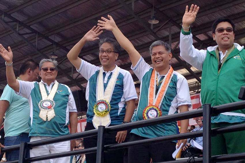Interior Secretary Mar Roxas waves to the crowd during the opening of the 2015 Palarong Pambansa in Tagum City, Davao del Norte on Monday. He was joined by (L-R) Governor Rodolfo Del Rosario, Education Secretary Bro. Armin Luistro, FSC and Davao del Norte 1st District Representative Anthony del Rosario. (Mart D. Sambalud/davaotoday.com)