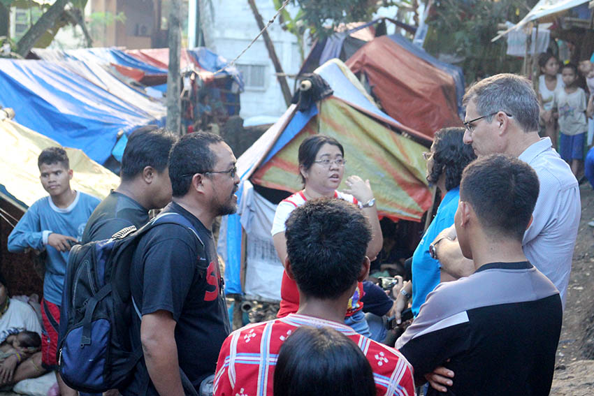 Personnel from the United Nations High Commissioner for Refugees (UNHCR), led by head of Mindanao operations Peter Deck, visit Lumad evacuees in a church compound in Davao City. (John Rizle Saligumba/davaotoday.com)