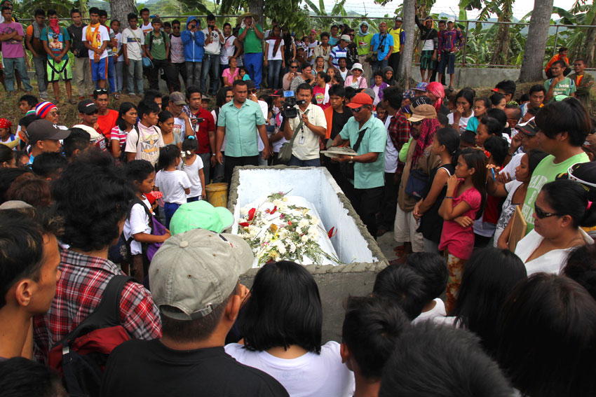 Emerito Samarca's casket is surrounded by thousands of people who paid their last respects during his funeral on Saturday.