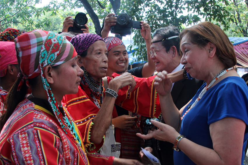 A Matigsalog leader from Talaingod, Davao del Norte, Bai Bibyaon Bigkay, gives a necklace to Atty. Rosario Setias-Reyes (in white), president of the Integrated Bar of the Philippines, to show her tribe's gratitude on the assurance of the lawyers group to help the Lumads on their call to stop the killings of their leaders and tribal members. (Earl O. Condeza/davaotoday.com)