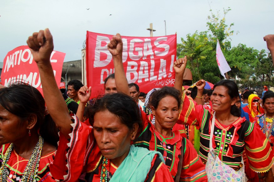 Manobo women raise their fists as they join the workers march in Davao City. They also called for the immediate release of the calamity funds for the El Niño affected area.