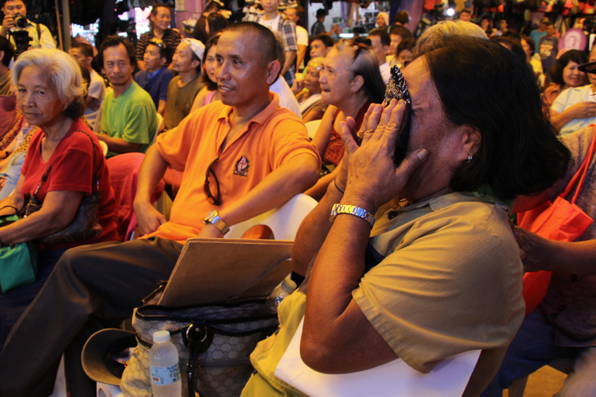 Lydia Rufino, 54, from Barangay Lapu-Lapu, Agdao district, Davao City cries while watching Philippine President Rodrigo Duterte deliver his inauguration speech shown through a projector screen inside the Mallengke in Bankerohan Public Market. Rufino said she did not expect that the long-time mayor from Davao City will be sworn into the Presidency. (Ace R.Morandante/davaotoday.com)