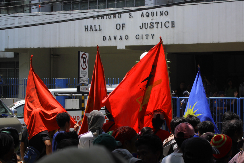Almost 1,000 protesters march to the Hall of Justice in Davao City to condemn the alleged trumped-up cases filed against 15 leaders of progressive organizations. The warrant of arrest for cases of kidnapping and serious illegal detention of the indigenous people's evacuees in Davao City is issued on May 13 by Judge Retrina Fuentes of Regional Trial Court 10 . (Ace R.Morandante/davaotoday.com)