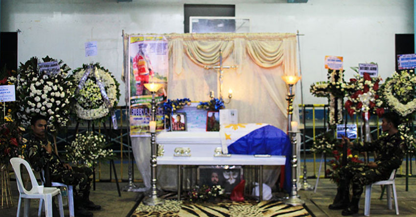 GUARDS. Two soldiers sit on both sides of the slain tribal leader, Ruben Labawan's coffin in the latter's last day of wake on Thursday, July 14.  (Paulo C. Rizal/davaotoday.com)