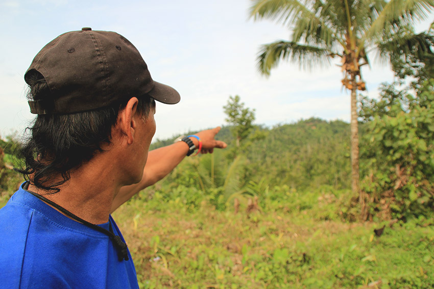 ENCOUNTER SITE. Purok 4 Chairman Lino Inbad points to where the encounter between the New People's Army and the government troops happened last August 4, 2016. (Earl O. Condeza/davaotoday.com)