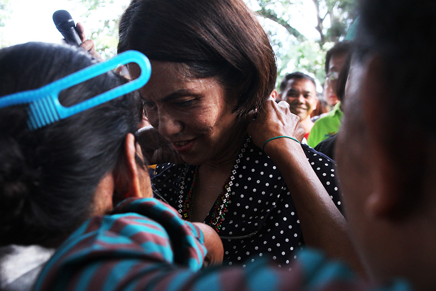Environment and Natural Resources Secretary Gina Lopez receives a necklace from a Lumad woman during her visit at the United Church of Christ in the Philippines Haran compound, in Father Selga Street, Davao City, on Friday, August 5. The church compound remains a sanctuary for more than 300 indigenous people's evacuees who were displaced due to alleged harassment and threats from paramilitary groups and soldiers. (Paulo C. Rizal/davaotoday.com)