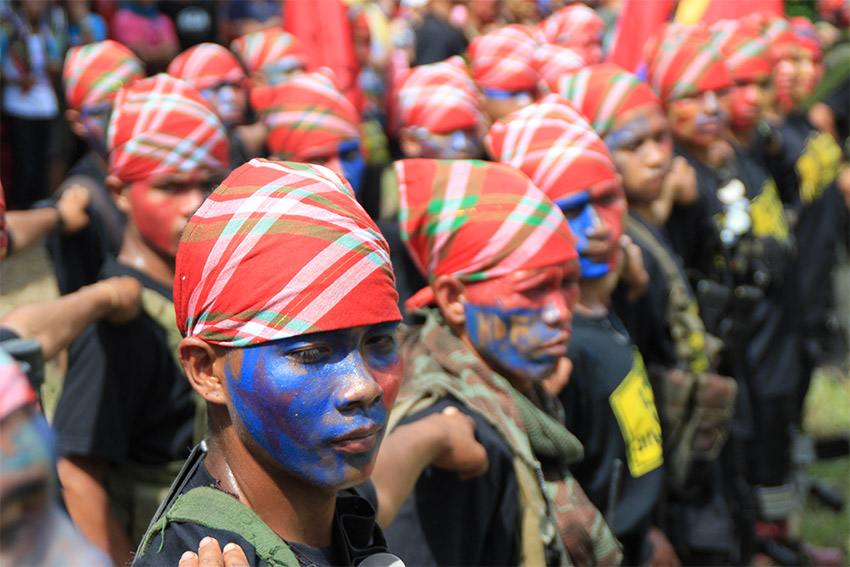 Guerrilla fighters of the New People's Army prepare their formation at the start of the ceremony for the release of its two captive police officers in a village in Lupon, Davao Oriental on Friday, August 26, 2016. (Earl O. Condeza/davaotoday.com file photo)