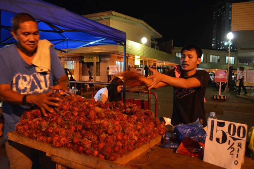 Fruit venders display Rambutan on top of a table bearing a price tag P15 for a 1/2-kilo.  (Medel V. Hernani/davaotoday.com)