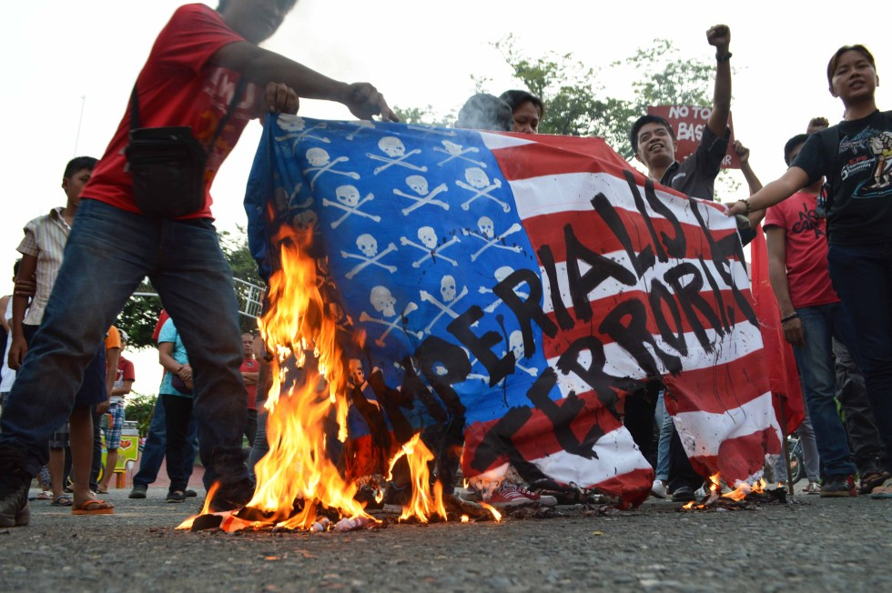 Davao City protesters burn a US flag to.protest its war on terror.