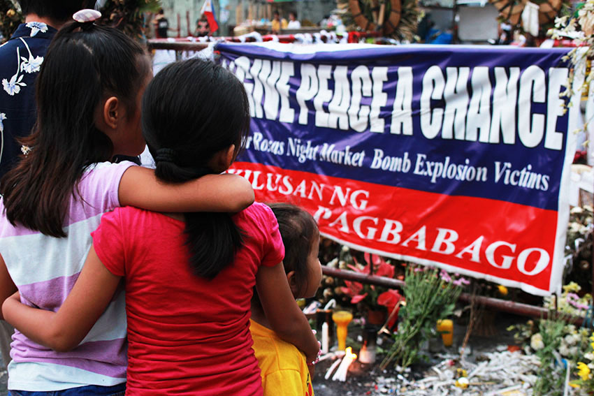 DAVAO BOMBING MEMORIAL. Everyday since the Davao bombing incident that claimed the lives of 15 and wounded 69 others, people from all over the city visit blast site along Roxas Avenue at different times of the day to light candles and offer flowers and prayers. (Paulo C. Rizal/davaotoday.com)
