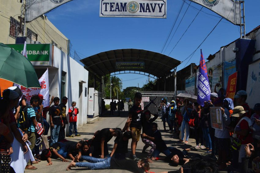A youth group performs a cultural presentation in front of the  Eastern Mindanao Command  Headquarter at Naval Station Felix Apolinario in Panacan, Davao City depicting the militarization of Lumad and peasant communities in Davao region during the global observance of the International Human Rights Day on Saturday, Dec. 10. (Medel V. Hernani/davaotoday.com)