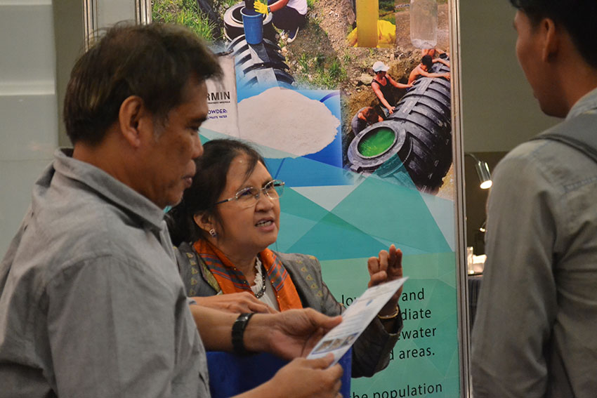 "WATER TREATMENT. Merlinda A. Palencia, a professor from Adamson University, explains the benefits of ""Virgomin"" to both humans and the environment. Virgomin, an eco-friendly septic water treatment, is one of the products and technologies exhibited on Tuesday, Dec. 13, during the Mindanao-wide Technology Transfer Day held at the SMX Convention Center in Davao City. (Robby Joy Salveron/davaotoday.com)"