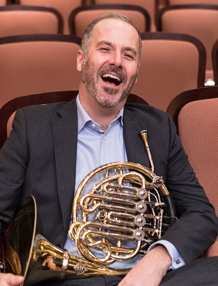 Camerata founder Adrian Spence tries to laugh it off when caught fondling Owen's horn 1/20/17 Hahn Hall, Music Academy of the West