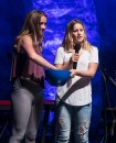 Granddaughter and local resident Olivia Irion (r) & friend announce the winner of a Gibson guitar raffled of to raise money for SB Middle School 4/11/17 The Lobero Theatre