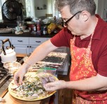 Nils Bernstein puts the finishing touches on Fiesta Party appetizers 8/5/17 Susanna Vapnek's residence