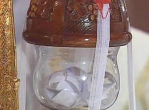 The glass vessel which contains the names of the three papal candidates.