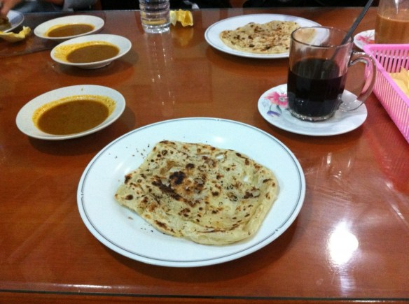 Strong local coffee and roti dipped in curry was to be our sustenance for the morning.