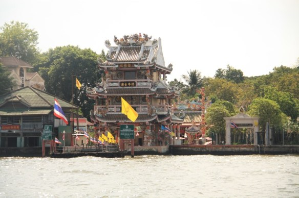 An ornate ferry stop on the side of the river.