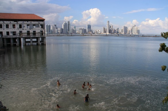 I like this shot of kids swimming with the cityscape backdrop.