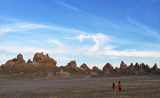 Kids walking across the large lot next to the Trona Pinnacles where a couple RVs were parked for the nght