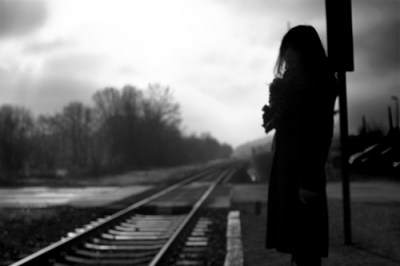 woman by tracks