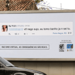 Activists display people's racist tweets on billboards outside their homes