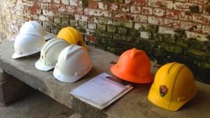 construction-hardhats-brick-bkgd