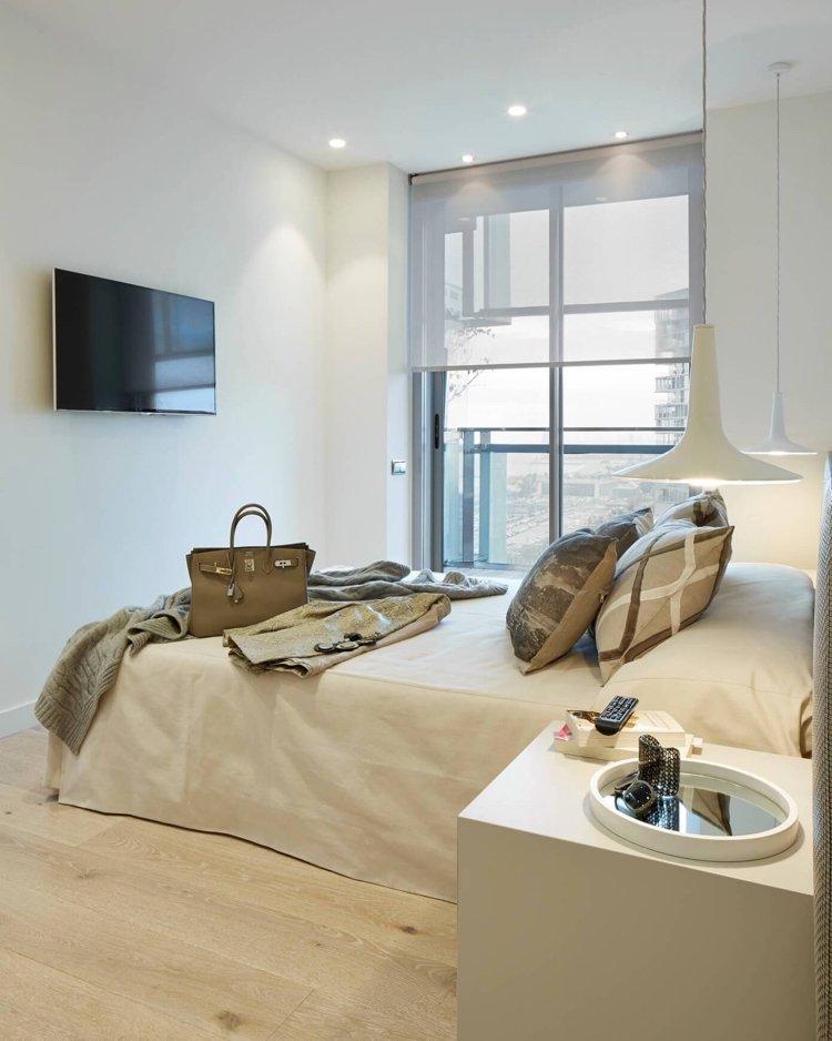 Wandfarbe Cremeweiß - weiße Wohnwelt in Barcelona - schlafzimmer creme wei