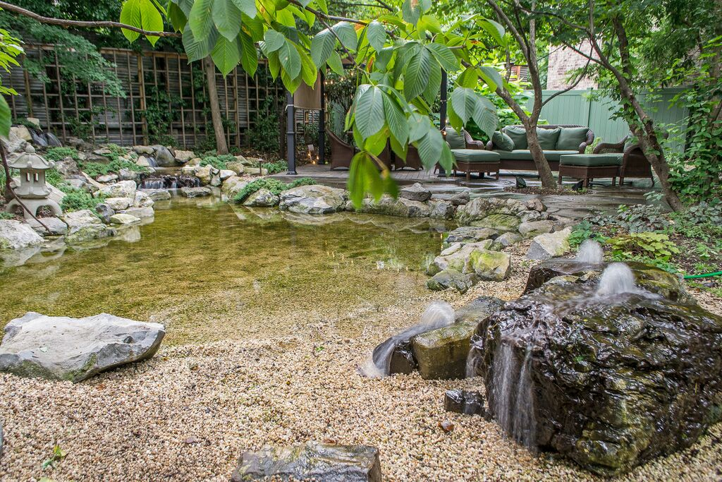 Natural Playscapes Pond And Playground Oasis In City Backyard