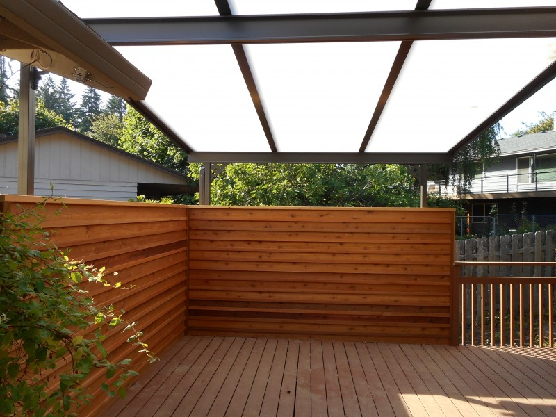 Acrylite patio cover with privacy screen Deck Masters, LLC