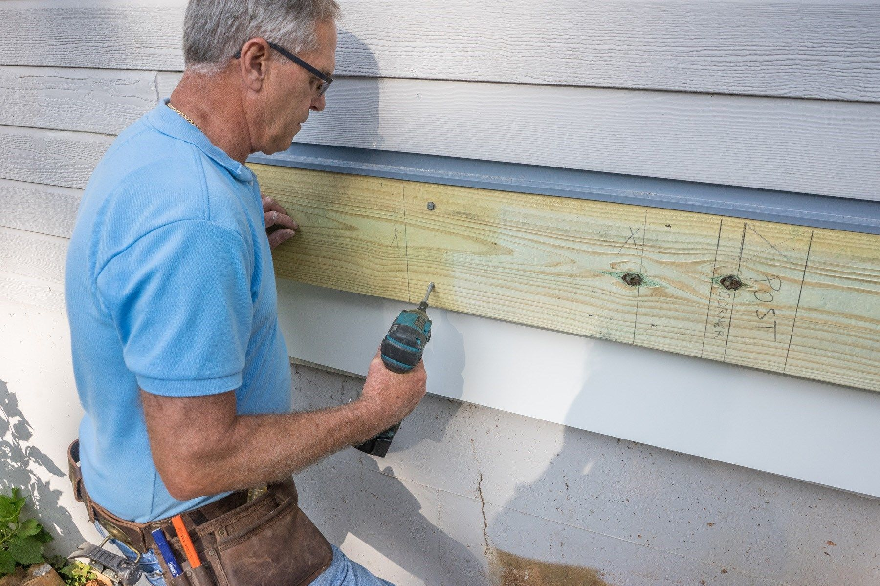 Use structural screws to attach the ledger to the house