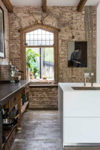 Exposed Brick Walls In A Modernized Interior - Decoholic