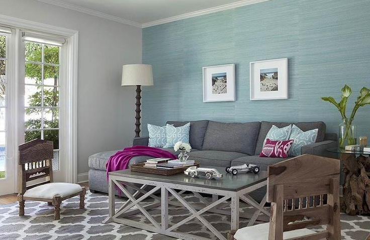 Blue and grey living room with wooden furniture