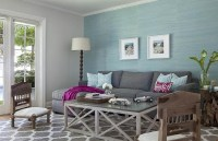 Blue and grey living room with wooden furniture ...