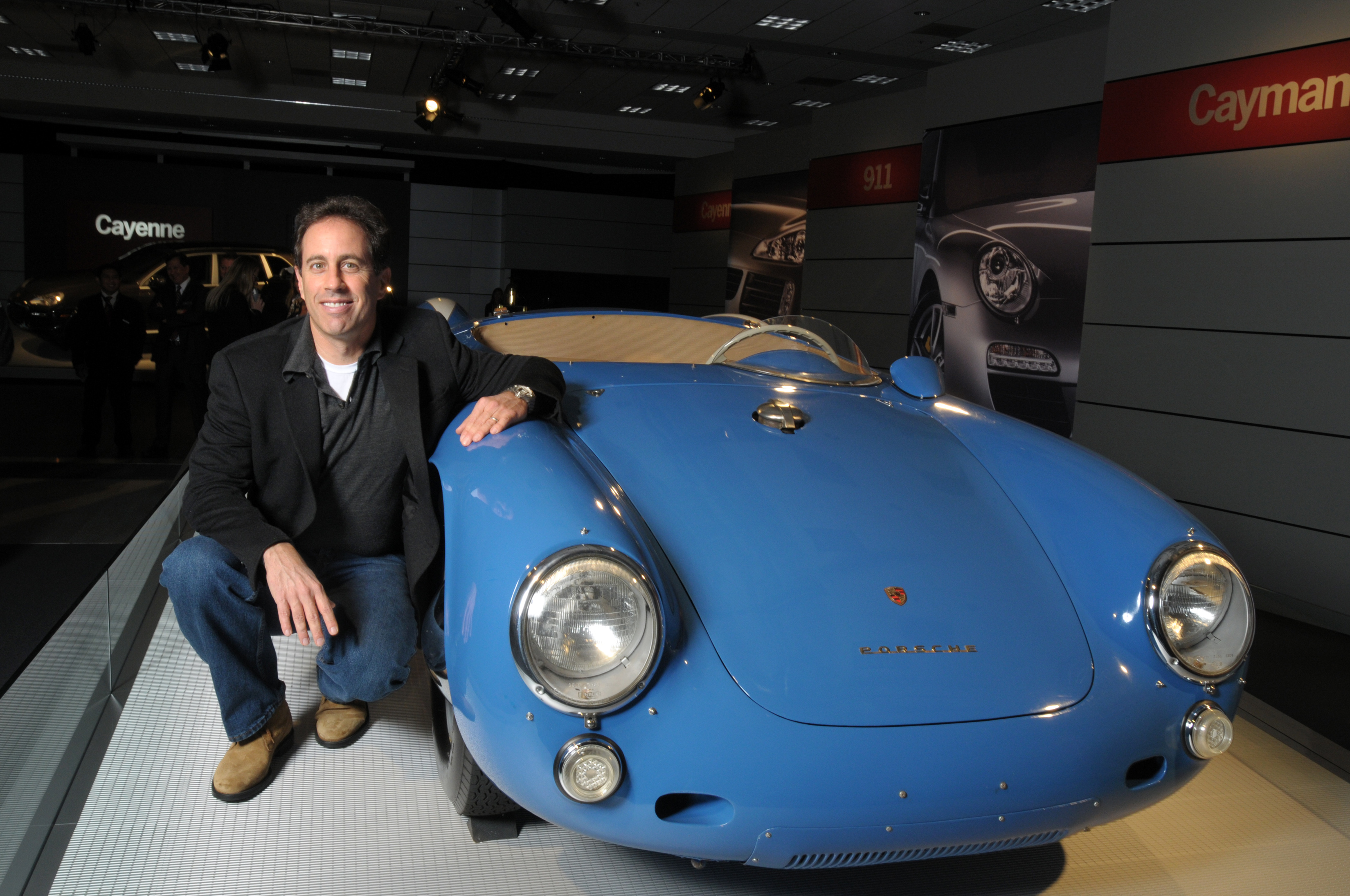 Home gt steve mcqueen porsche paintings jerry seinfeld poses with his 1955 porsche spyder on download