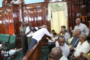 Then Opposition Leader David Granger greets several of the pensioners in the Public Gallery of the National Assembly