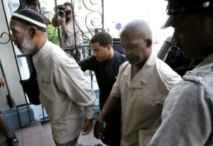 AP Photo: Kareem Ibrahim, (left), and Guyanan Abdul Kadir arrive to the Magistrate Court for an extradition hearing in Port-of-Spain, Trinidad in this 2007 photo.