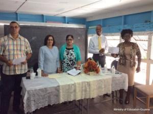 from left-Kirk Jardine, Dr. Latchmin, Mrs. Seeta Nagamootoo, Pastor Eworth Williams,Mrs. Glenna Vyphius, Chief Schools Welfare Officer.