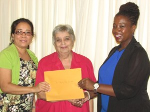 :  Representatives of the Step by Step Foundation for children with autism receives their organisation's support from CSR Manager Ayaana Jean-Baptiste (at right)